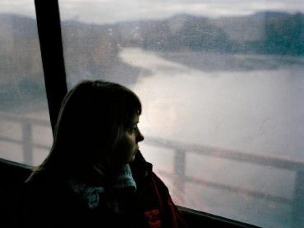 woman bus window